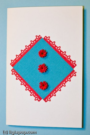 Card 22: Blue squares and red flowers