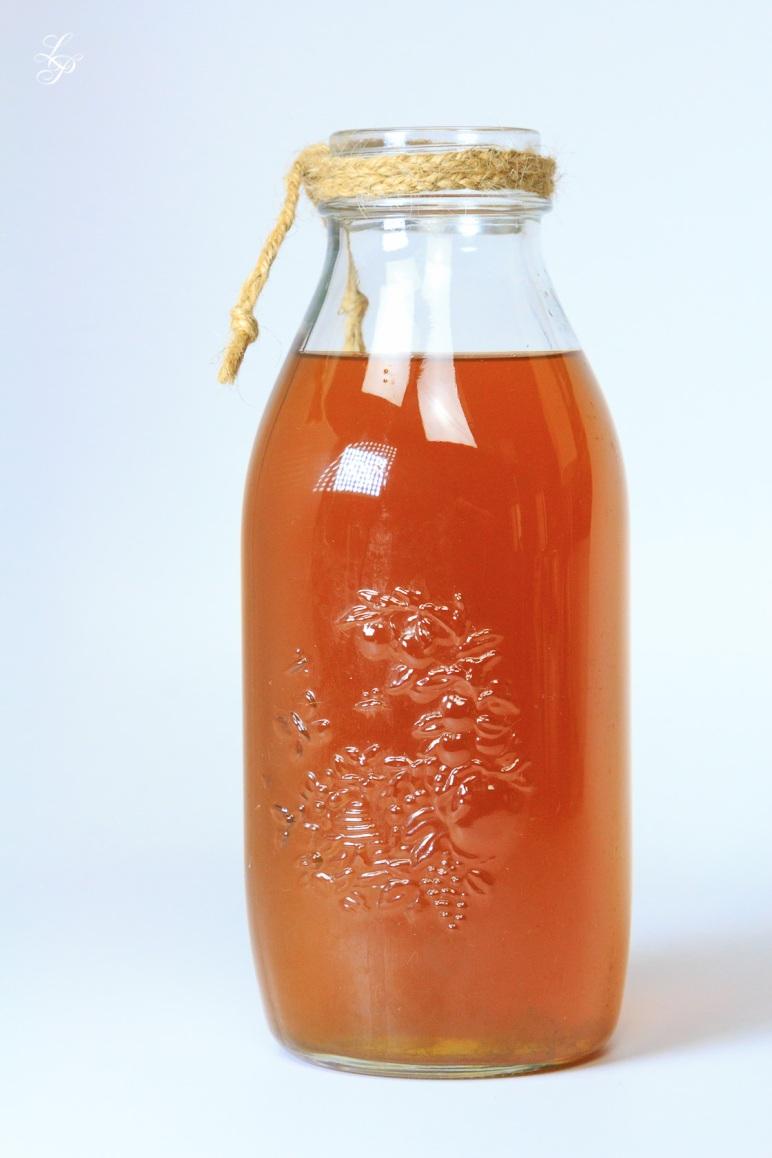 A bottle of freshly prepared Kombucha.